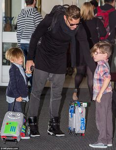 Mini Martins: Ricky Martin and his five-year-old twins Valentino and Matteo were spotted at Sydney airport on Friday