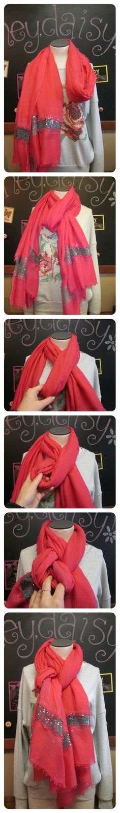 Fold scarf in half, and wrap around neck.  Thread one end through loop.  Give the loop a half twist and thread the other end through.