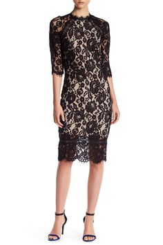 "Mock Neck Lace Dress by Just Me  Details - Mock neck - 3/4 length sleeves - Back zip closure - Allover lace knit construction - Approx. 44"" length (size S) - Imported Fiber Content Shell: 100% nylon Lining: 100% polyester Color: Black-Nude $94 (on sale for $49.97)"
