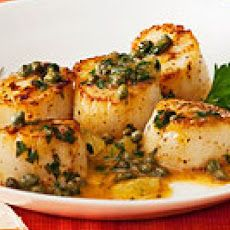 Lemon Caper Scallops-Season scallops. In a large skillet, melt 1 tbsp butter over medium-high. Add scallops; cook until golden, 3 minutes. Transfer to plate. Brown remaining butter. Add remaining ingredients; season. Spoon over scallops.