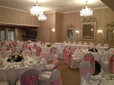 Rowton Hall wedding, chair covers with pink sashes