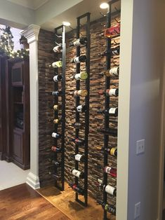 A wine cellar made up of VintageView wine racks on a floor t.- A wine cellar made up of VintageView wine racks on a floor to ceiling frame A wine cellar made up of VintageView wine racks on a floor to ceiling frame - Wine Cellar Basement, Wine Cellar Racks, Wine Rack Wall, Metal Wine Racks, Cool Wine Racks, Glass Wine Cellar, Wine Wall Decor, Wine Rack Design, Wine Cellar Design