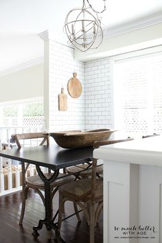 restoration hardware light table chairs / Industrial Vintage French kitchen | somuchbetterwithage.com