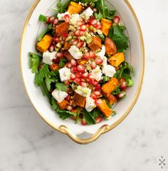 Sweet Potato & Pomegranate Salad: 2 med sweet potatoes (cubed) + olive oil, salt & pepper for roasting.  2 cups baby salad greens (kale, spinach, arugula etc.). 1/3 cup pomegranate seeds.  1/3 cup crumbled feta.  1/4 cup toasted pistachios (toasted & chopped).  handful chopped cilantro.  2-3 chopped scallions, white & green parts.   Dressing: 2 Tbsp olive oil.  1/2 clove minced garlic.  2 tsp honey.  1 tsp white wine vinegar.  salt & pepper, to taste.
