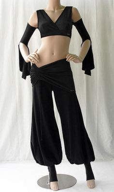 Scarlet's Lounge Bra-choli top w/ Gypsy Sleeves Black (cut off sleeves for this performance).  Also, the pants are available on her website and would work for Delilah too.