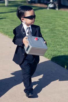 "This is a hilarious ring bearer idea. More weddings need to have fun like this. Laughter produces more fond memories than ""safe"" and ""typical"" formal/classical weddings."