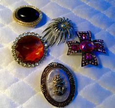 """""""Saved"""" brooches with their original clasps"""
