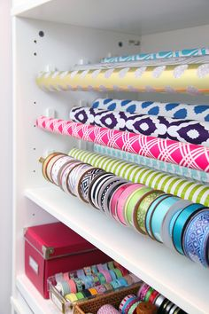 DIY Gift Wrap Organization Station:  Use curtain rod tension rods to keep in place.