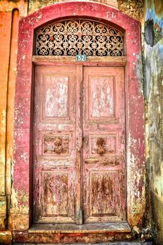 """In the universe, there are things that are known, and things that are unknown, and in between, there are doors.""  ― William Blake...  Old Door. Greece."