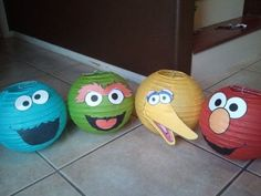 Paper lanterns decorated like Cookie Monster, Oscar the Grouch, Big Bird and Elmo. See more Elmo birthday party ideas at www.one-stop-party-ideas.com