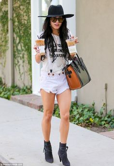 Legging it: Vanessa Hudgens turned heads in tiny white shorts as she grabbed a couple of iced coffees on the go on Thursday