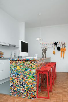 From Lego-tastic colors to sleek teak, these modern islands transform the kitchen. Munchausen Design Studio, Simon Pillard, and Philippe Rossetti covered a simple wooden island with 20,000 Lego pieces to serve as a dazzling companion to a Lego chair they designed in 2005.