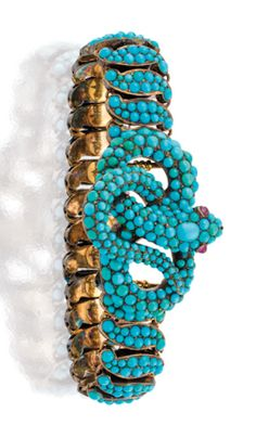 18CT GOLD, TURQUOISE AND RUBY EXPANDING BRACELET, T.S. DISMORE & SONS, 1841, Centring an open work coiled snake pave-set all over with turquoise, the eyes highlighted with a cabochon ruby completed by a line of similarly set hinged S-shaped links between sprung baton links applied with blue enamel, signed T S Dismore & Sons, dated 1 Nov 1841, numbered 897.