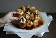 Chocolate Chip Cheesecake Stuffed Monkey Bread | Dough-Eyed Magic happens when two delicious desserts are combined into one. All the creaminess of cheesecake wrapped in cinnamon-sugar dough and baked to perfection!