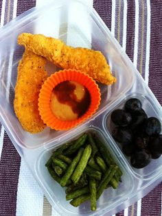 Chicken Tenders with honey mustard Hot Sauce, green bean (fresh?), grapes.