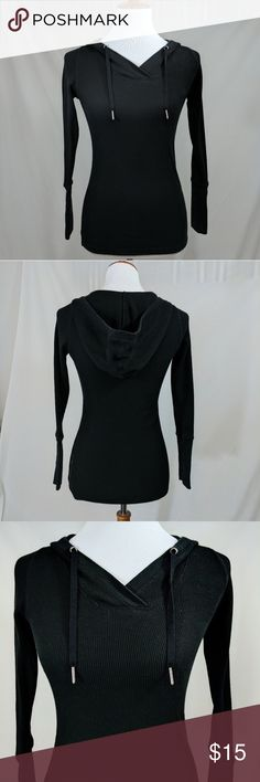 """Calvin Klein Black Ribbed Pullover with Hood Calvin Klein Performance Quick Dry hooded pullover top.  Ribbed knit, v-neck, shoelace draw string hood.  Fitted, feminine shape.  Long sleeves with 6 1/2"""" plain cuffs.  Length underarm to bottom 17"""",chest pit to pit 16"""".  Black is slightly faded but otherwise in excellent condition!  Great look with distressed jeans or skirt! Calvin Klein Tops Sweatshirts & Hoodies"""