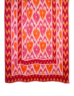 Zig-zag strokes of deep fuschia and marigold border bird-like washes of berry and tangerine in this vibrant coral tie-all