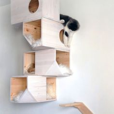 A cat tower that also acts as wall decor from Catissa, complete with a staircase and sheep skin cushions good if u have cats