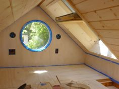 Solhaus tiny house - floor storage and round window