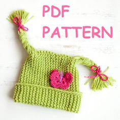 Baby hat knitting pattern — Children hat with braids and crochet butterfly