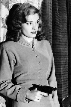 Beautifully dressed, the hair, the gun... the mystery...Jane Greer in Out of the Past, 1947