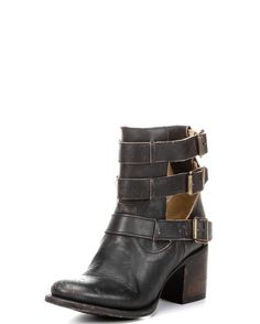 Distressed ankle bootie with opened up sides. Western inspired with 3 strap buckle closure and stacked heel.