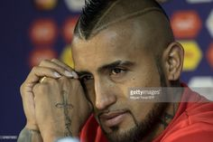 Arturo Vidal of Chile looks on during a press conference a day before the opening match of 2015 Copa America Chile between Chile and Ecuador at Nacional Stadium on June 10, 2015 in Santiago, Chile.