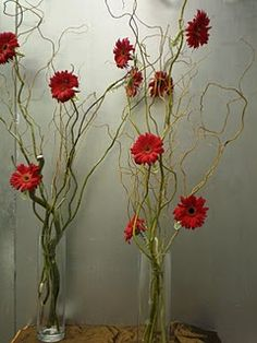 Another tall centerpiece with gerber daisies