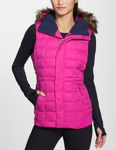 Love this bright pink North Face down vest.