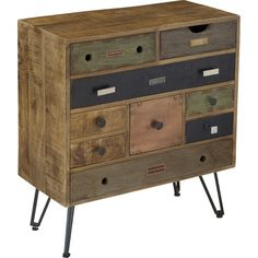 This nine drawer chest is loaded with personality. Metal legs support this unique and unpredictable storage unit. The multicolor mango finish means each of the drawers has a different shape, color and texture. Even the embellishments from the drawer pulls, to accents like nail heads and label holders differentiate.