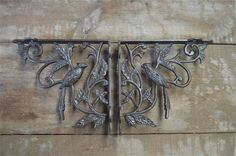 A pair of antique style Victorian exotic bird brackets AL23