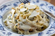 Fettucini in Parmesan-Roasted Garlic Cream Sauce with Chicken, Mushrooms, Toasted Walnuts and Fresh Thyme