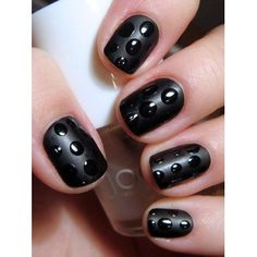Black-on-black polka dot nails