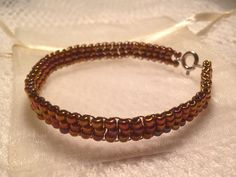Beaded bracelet - copper - handmade from quality Japanese seed beads. Includes cream organza gift bag. on Etsy, $12.50 AUD