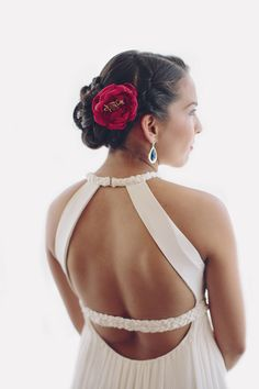 Braided updo with flower | Photography: Brooke Courtney Photography - brookecourtney.com