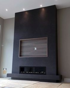 Black Fireplace Wall With Built In Wood Recessed Tv Frame # fireplace tv wall, Top 70 Best TV Wall Ideas - Living Room Television Designs Fireplace Tv Wall, Black Fireplace, Fireplace Design, Fireplace Feature Wall, Linear Fireplace, Fireplace Ideas, Black Feature Wall, Basement Fireplace, Fireplace Inserts