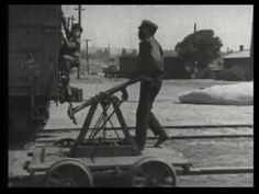 319. Our hero climbs the back of the train as the janitor continues pumping the handcar | Fast and Furious (1924)