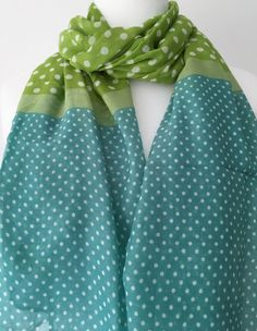 A large green polka dot scarf The scarf is long wide and very soft Measurements approx 71 inch 180 cm in length approx 27 5 inch 70 cm wide Material