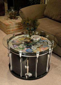 Drum table with old concert tickets and wrist bands...