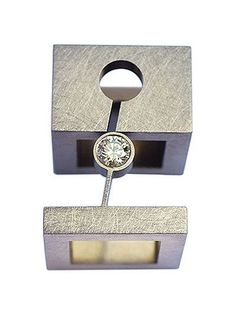 Yael Herman Ring: Puzzle ring 2007 Stainless Steel rings set with diamond