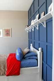 """Benjamin Moore """"Newburyport Blue"""" and the tan on the rest of the walls is Glidden's """"Scroll Beige."""""""