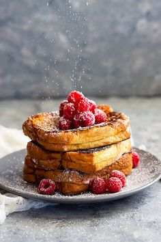Raspberry Cheesecake Stuffed French Toast -a great brunch recipe for any special occasion! Rich and buttery brioche bread stuffed with raspberry cheesecake and drizzled with hot fudge sauce. Pure decadence for breakfast!