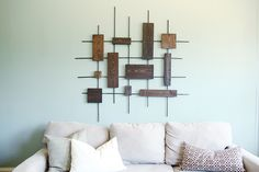 Wall art constructed of wooden boards and metal dowel rods. Cool idea that could be crafted to fit any room!