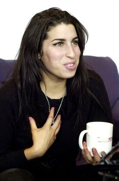 Amy Winehouse♡                                 The most beautiful smile in the world♡