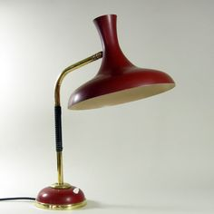 Mathieu Matégot; Brass and Enameled Metal Table Lamp for Disderot, 1950s.