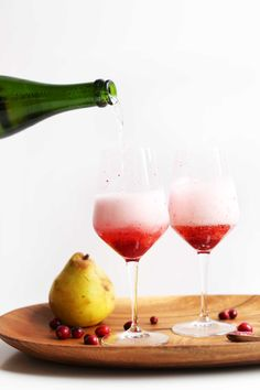 5-Ingredient Champagne Mimosas with Cranberry-Pear Reduction! Bubbly, tart-sweet, SO delicious + Perfect for NYE! #champagne #nyecocktail #cocktails