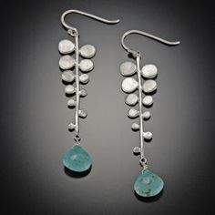 Fern Earrings with Turquoise. A vibrant turquoise teardrop hangs from a hammered sterling silver fern.