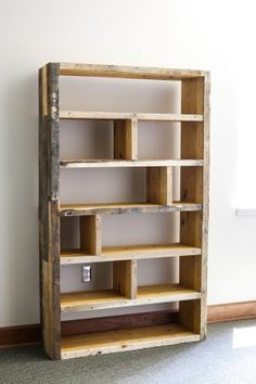 How to build a DIY pallet bookshelf love the way this is sectioned off