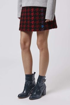 Stomp around the city in these Halston leather buckle boots. #Topshop
