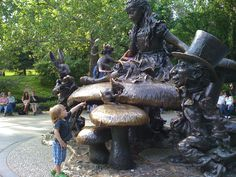 My son, a few years ago, at the Alice In Wonderland sculpture in Central Park.  I love all things Alice, and I love Central Park.